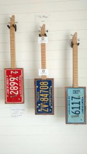 License plate guitars hanging on the wall